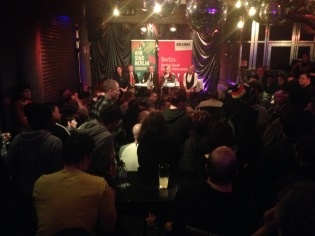 "picture of a panel discussion named ""refuggees welcome"" held by the Green Party and die Linke at Südblock."