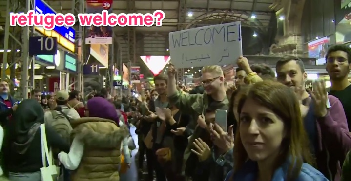 _1__Channel_4_News_-_Refugees_cheered_after_arriving_in_Germany