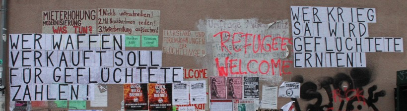 picture showing protest banners at the refugee camp in the former airport on Tempelhofer Feld